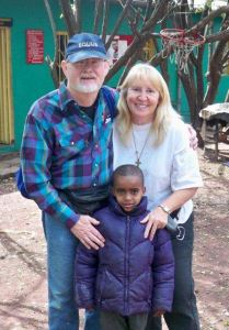 Cliff and Mary with Yonus, who has HIV/AIDS.