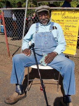 man sitting with a cane