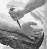 The nail going into Christ's hand