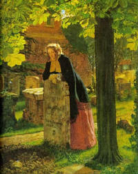 a woman leaning on a tombstone