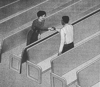 People standing in pews and shaking hands