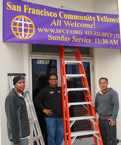 putting up the congregation's banner at their building