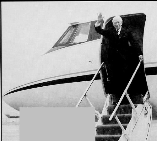 Herbert Amstrong waving from the entrance of the church-owned jet